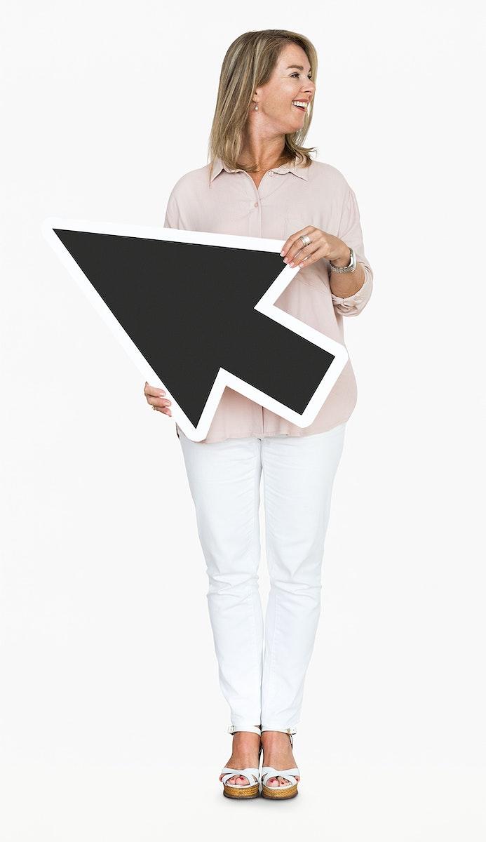 Happy woman holding a black arrow