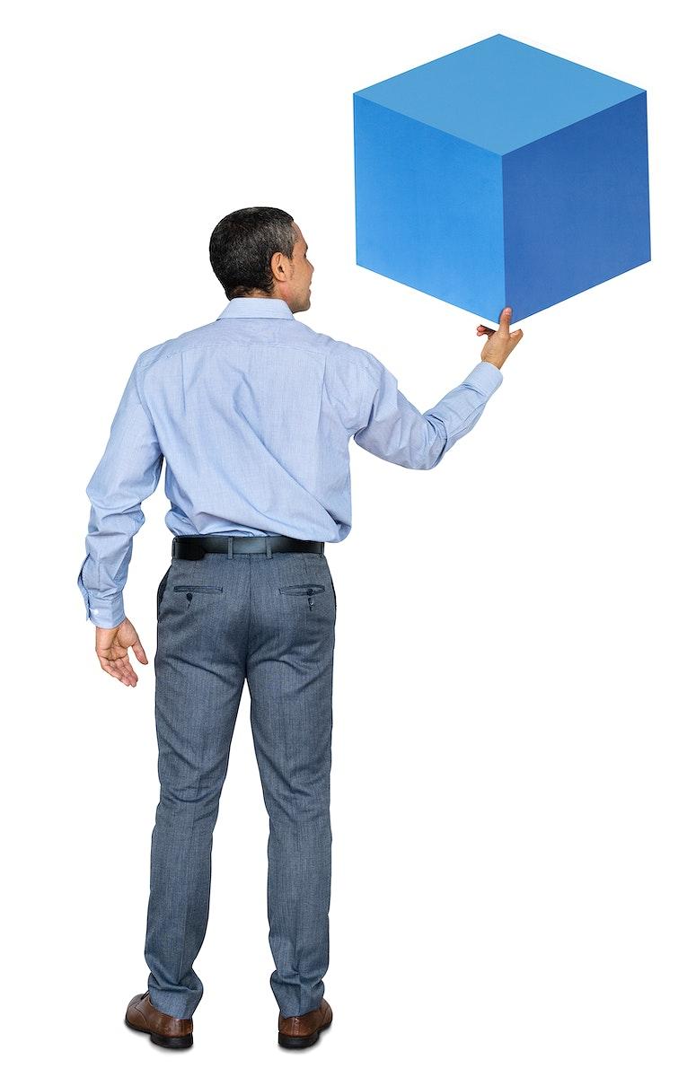 Businessman holding a blue box