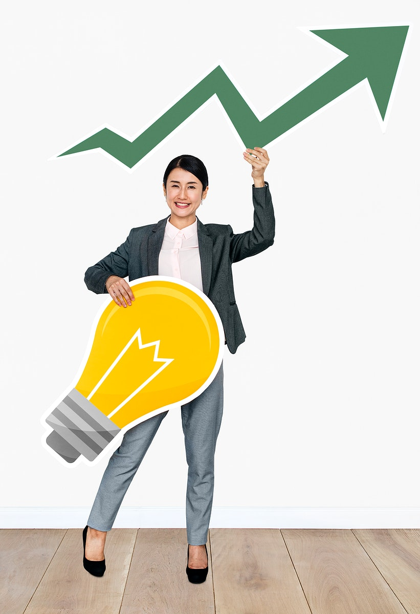 Businesswoman holding arrow and light bulb icons