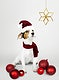 Adorable Jack Russell Retriever puppy wearing a Santa hat