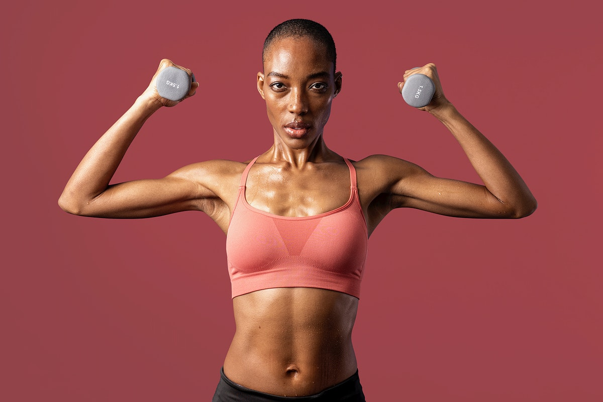Active black woman lifting dumbbells on red background mockup