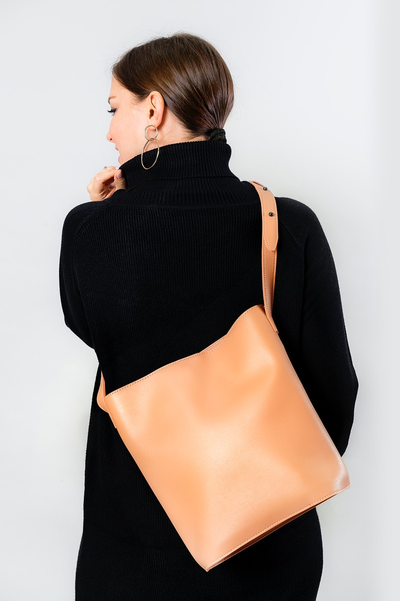 Woman from behind with a brown cross body bag