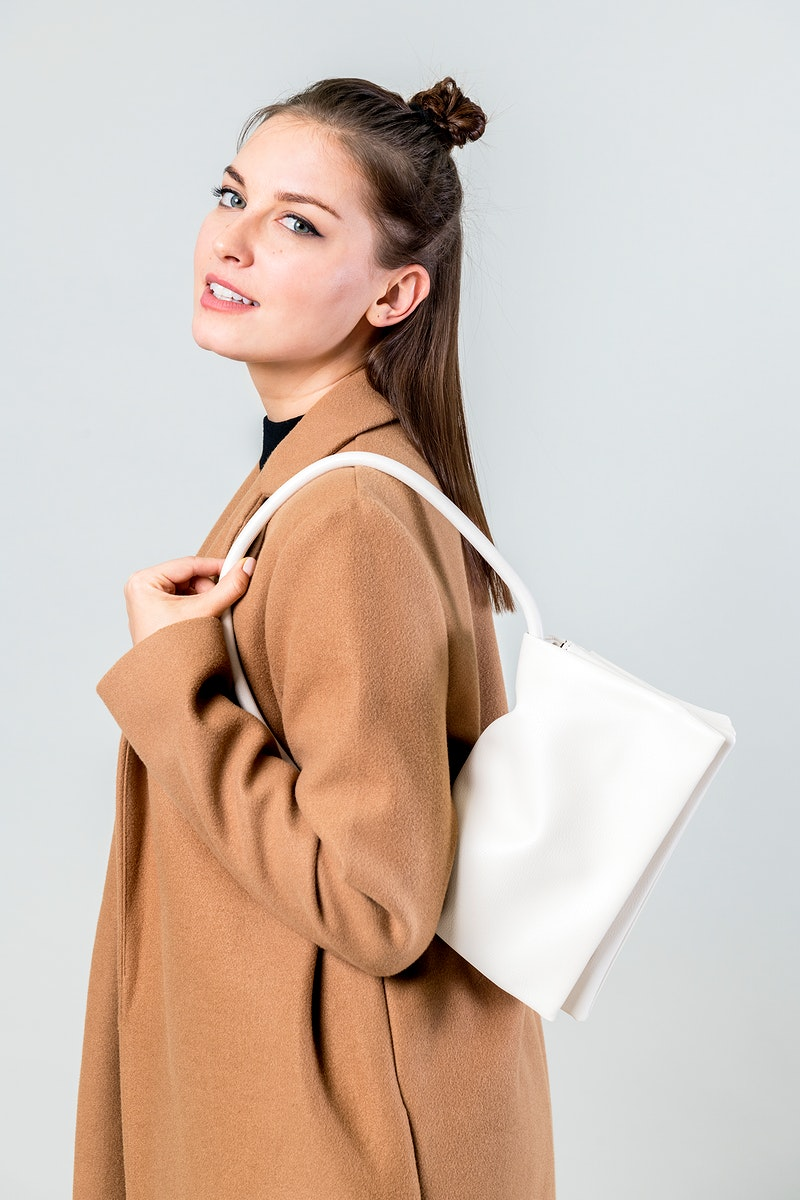 Woman with a white hand bag