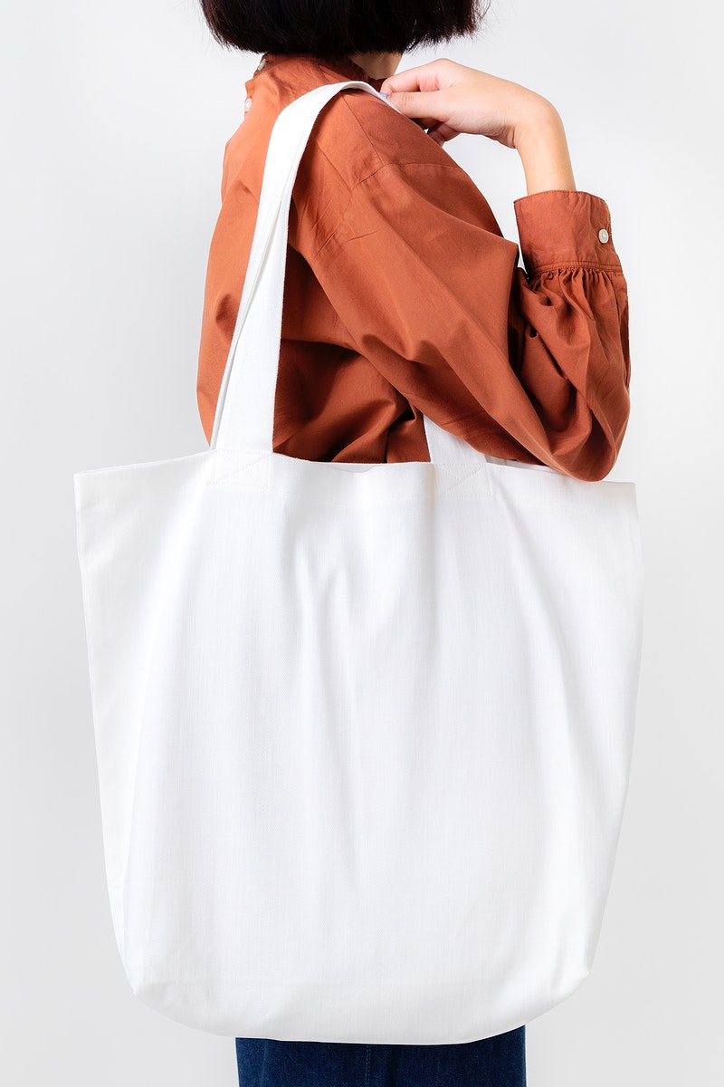 Woman with a white tote bag