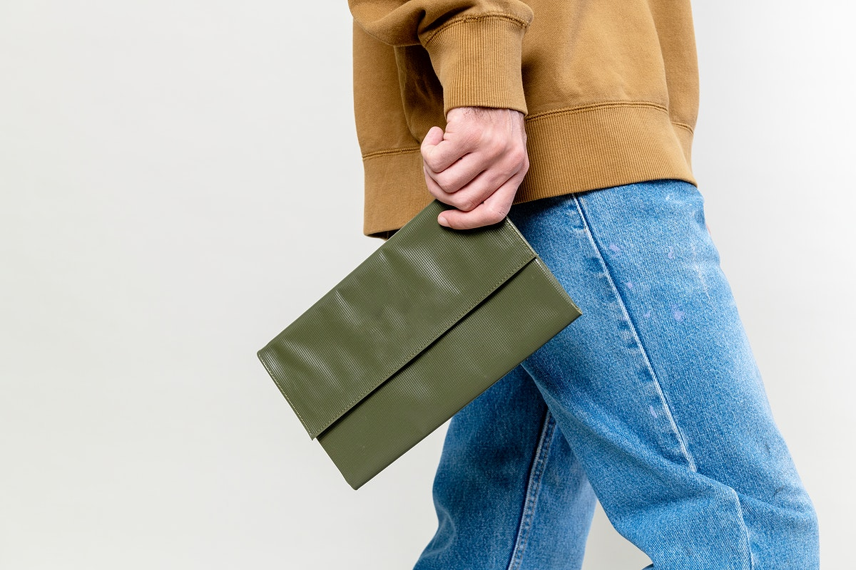 Woman with a green purse