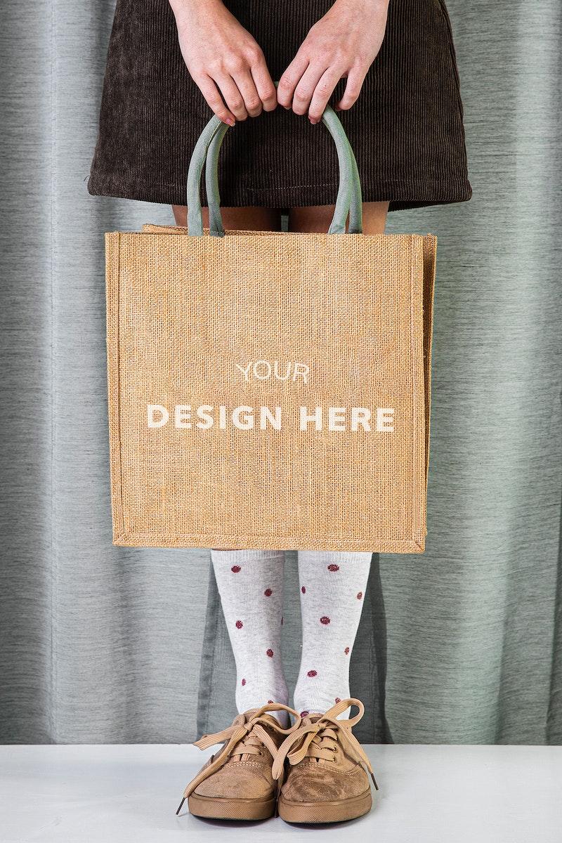 Woman with tote bag mockup