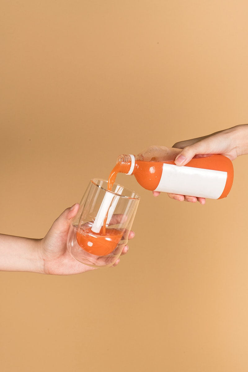 Cold-pressed carrot juice in a double wall glass