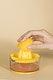 Woman making an orange juice from a manual juicer