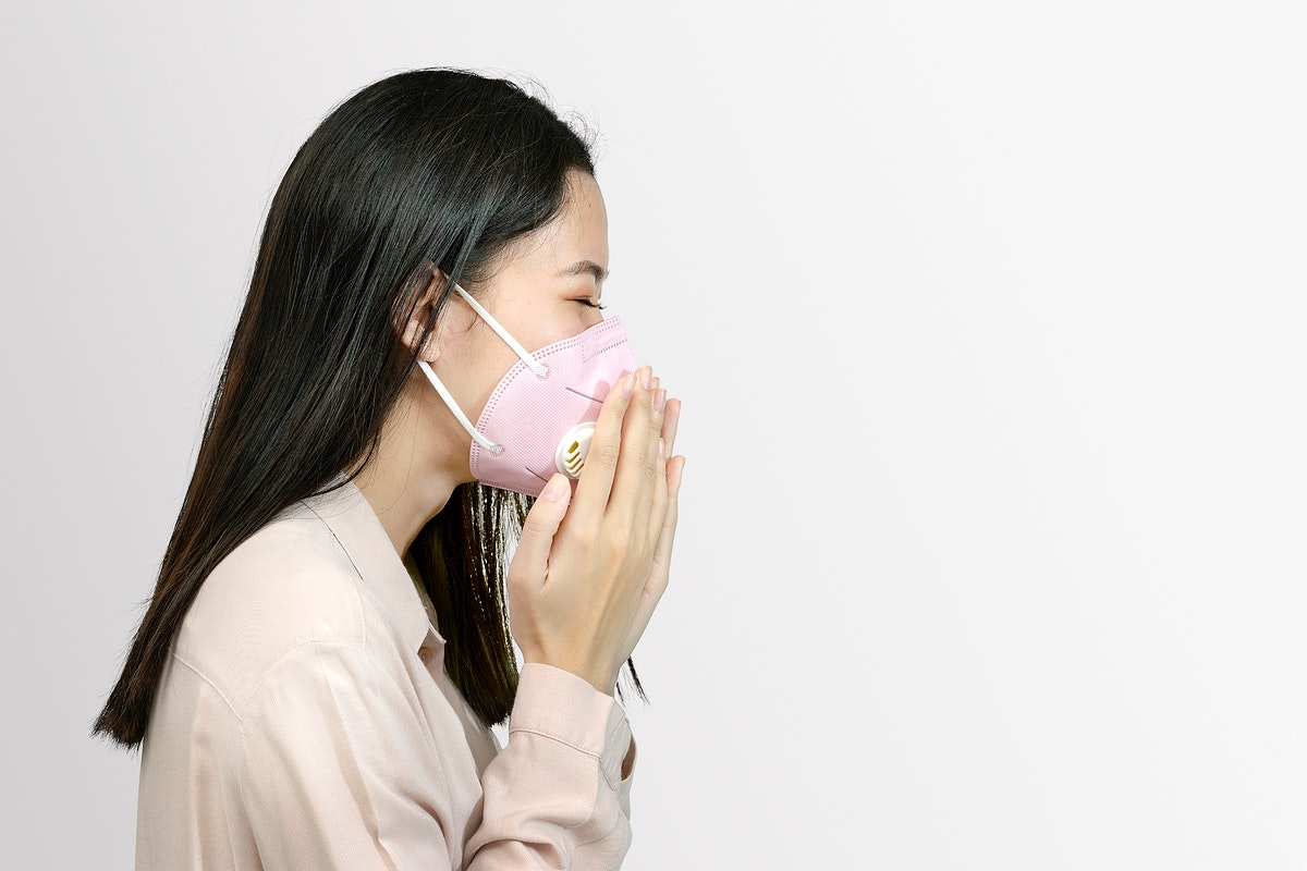 Asian woman wearing a mask and coughing mockup