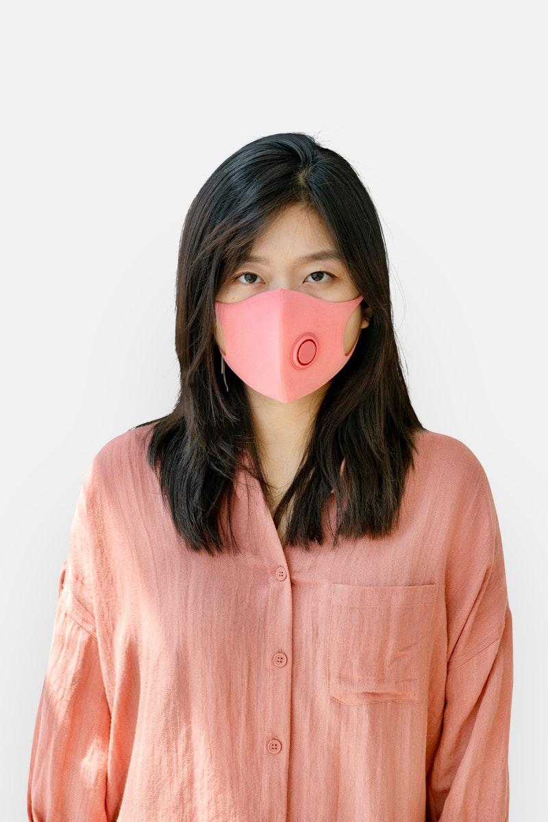 Korean woman wearing a face mask mockup