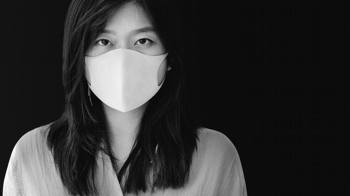 Asian woman wearing a mask mockup monotone