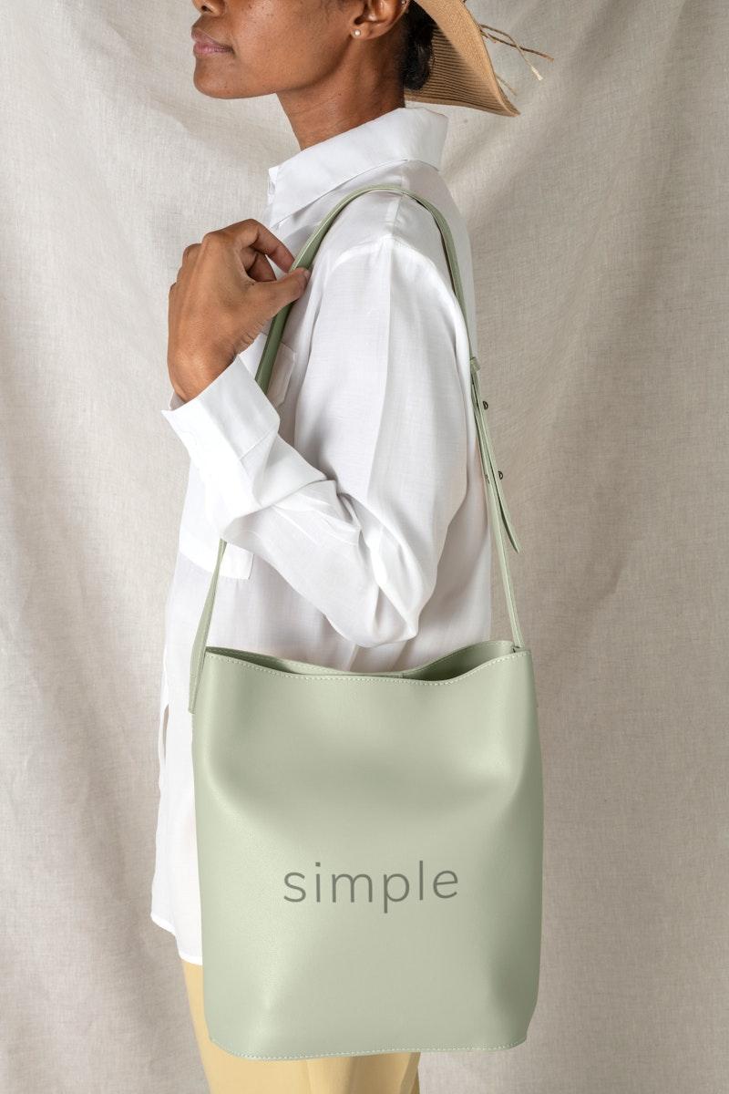 Black woman carrying a sage green shoulder bag mockup