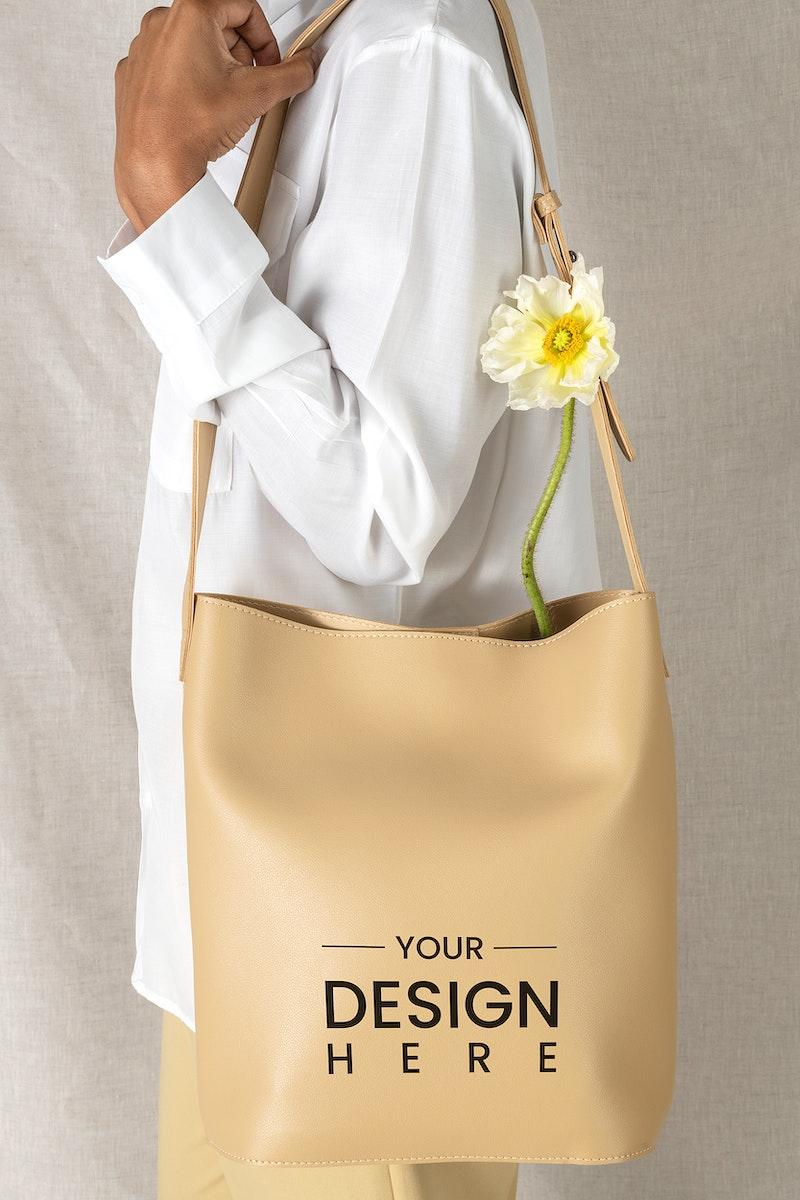 Black woman carrying a beige shoulder bag mockup