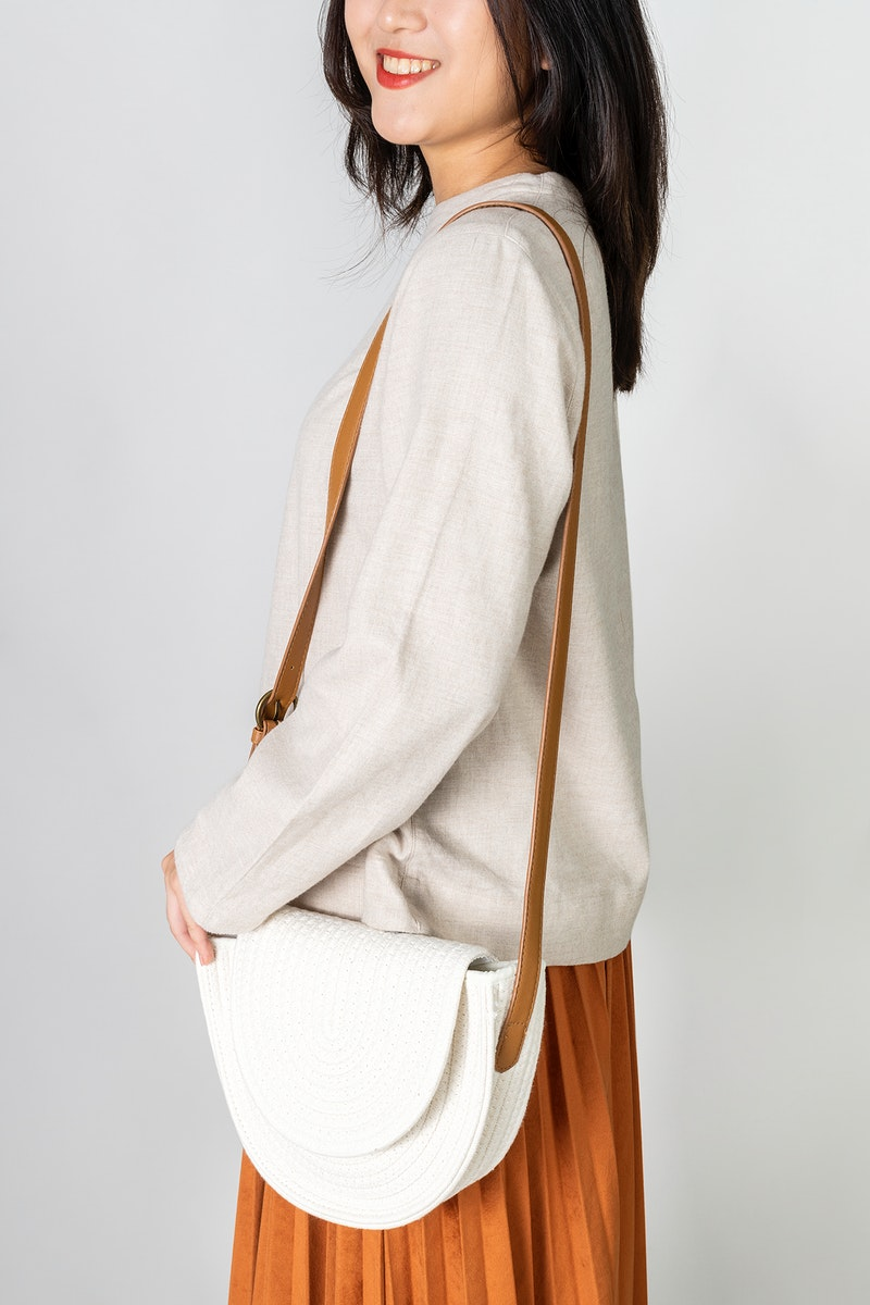 Asian woman carrying a white woven cotton rope bag mockup
