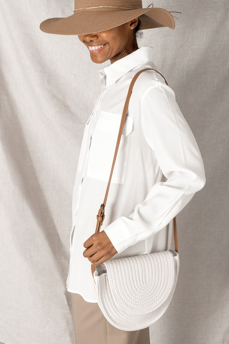 Black woman carrying a white woven cotton rope bag mockup