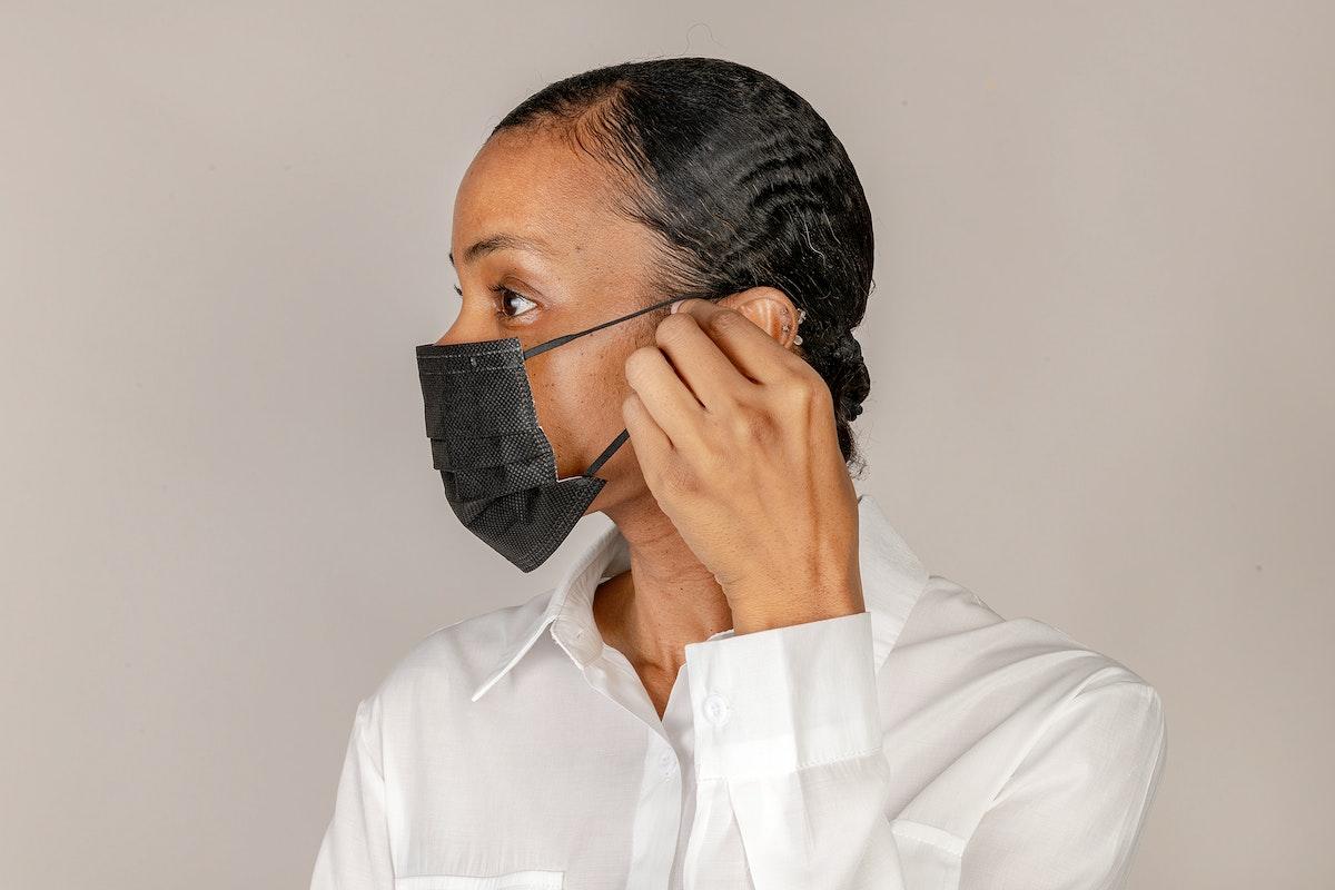 Black woman wearing a black mask