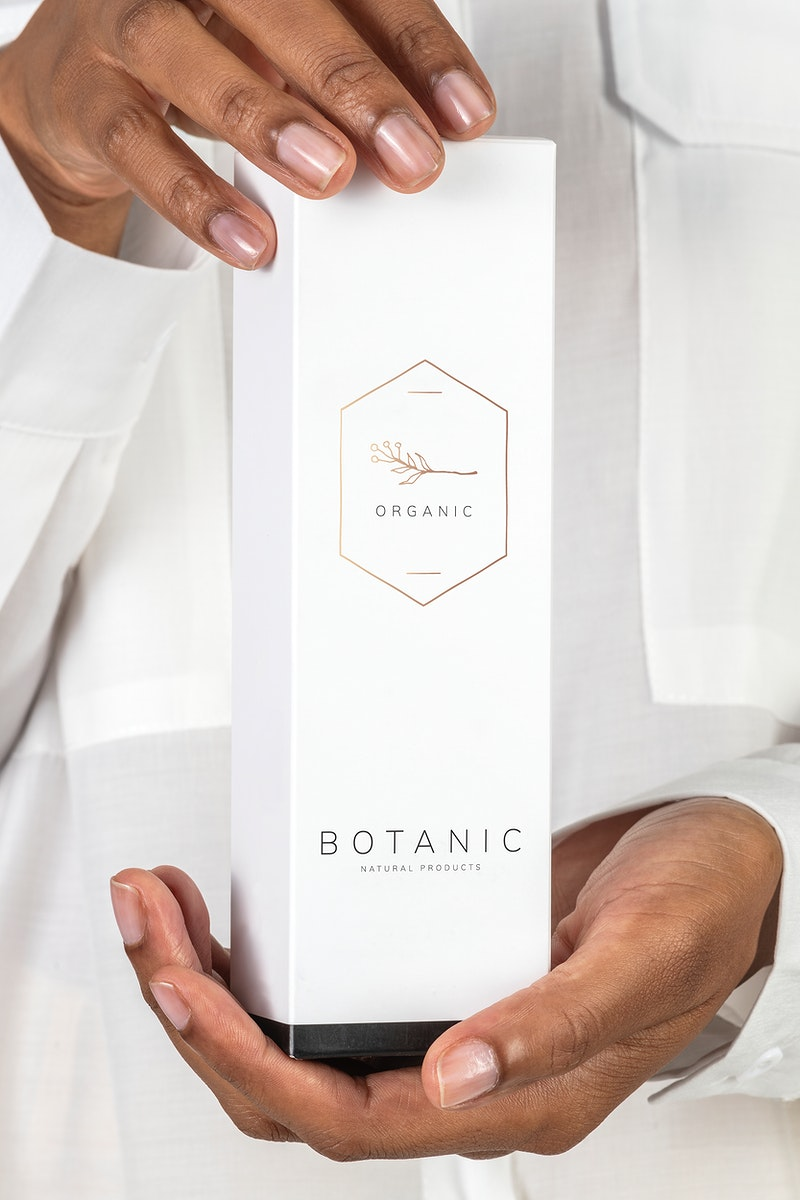 Hands holding a cosmetic packaging mockup