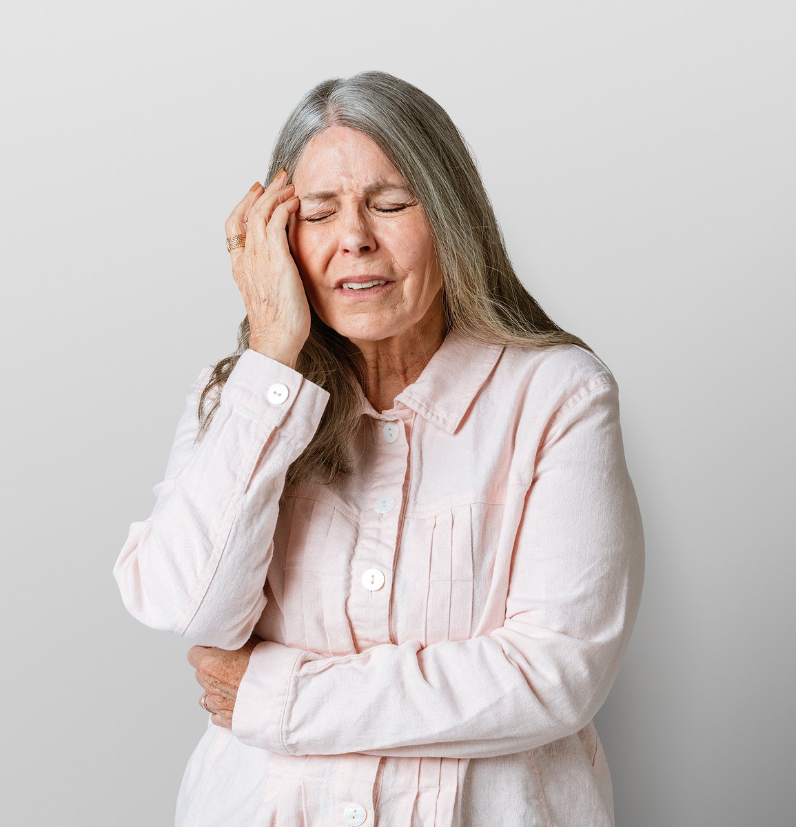 Sick senior woman having a headache during coronavirus pandemic mockup