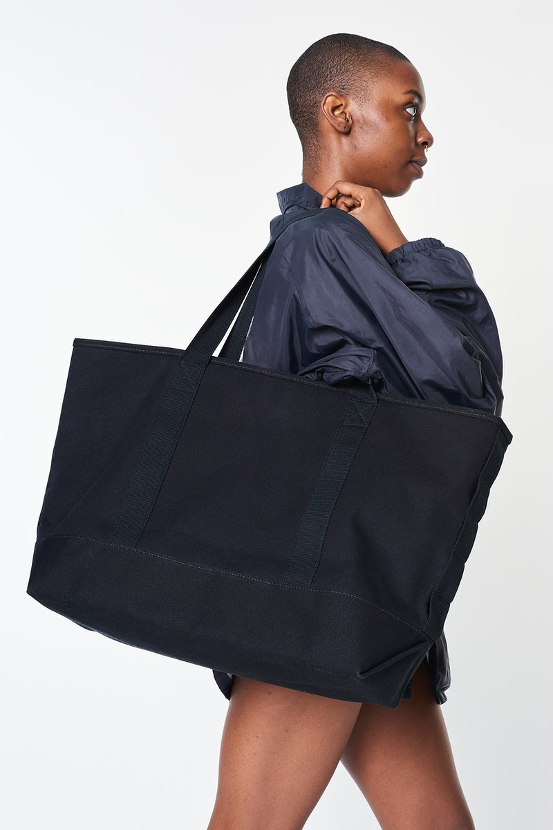 Black girl with a black oversized blank tote bag