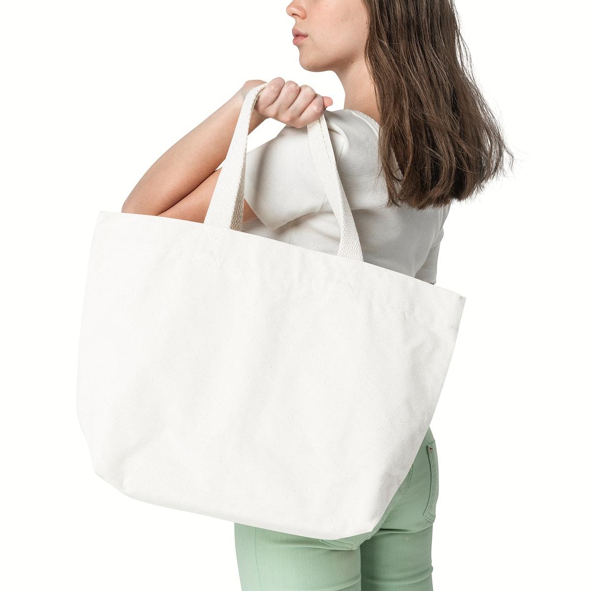 Beige tote bag psd mockup in canvas design apparel shoot