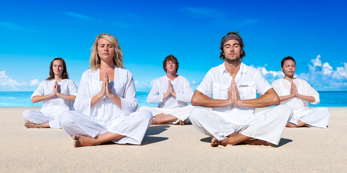 A group of people is meditating