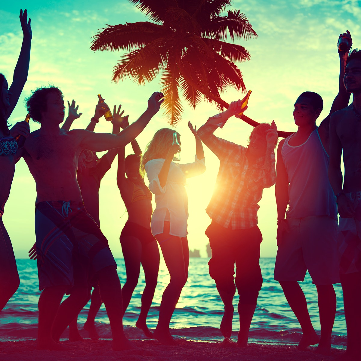 A group of diverse people is having fun at the beach
