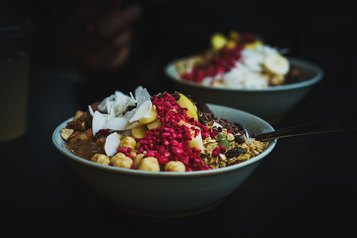 Healthy fruit bowls with coconut, berries, and nuts for breakfast. Original public domain image from Wikimedia Commons