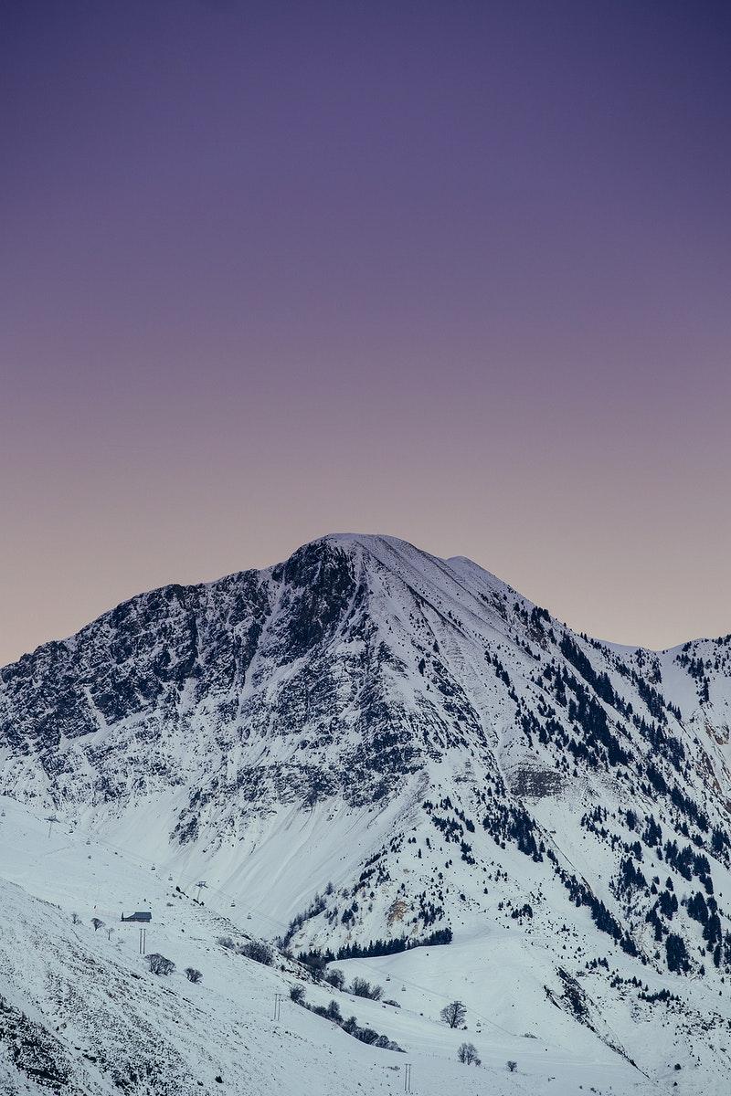 A snow-covered mountain against a light purple sky. Original public domain image from Wikimedia Commons