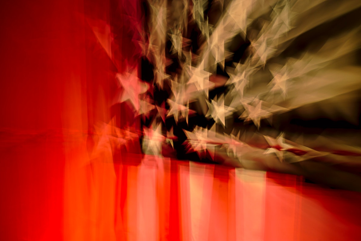 Blurry view of the stars and stripes on an American flag. Original public domain image from Wikimedia Commons