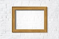 Wooden frame mockup on a brick wall vector