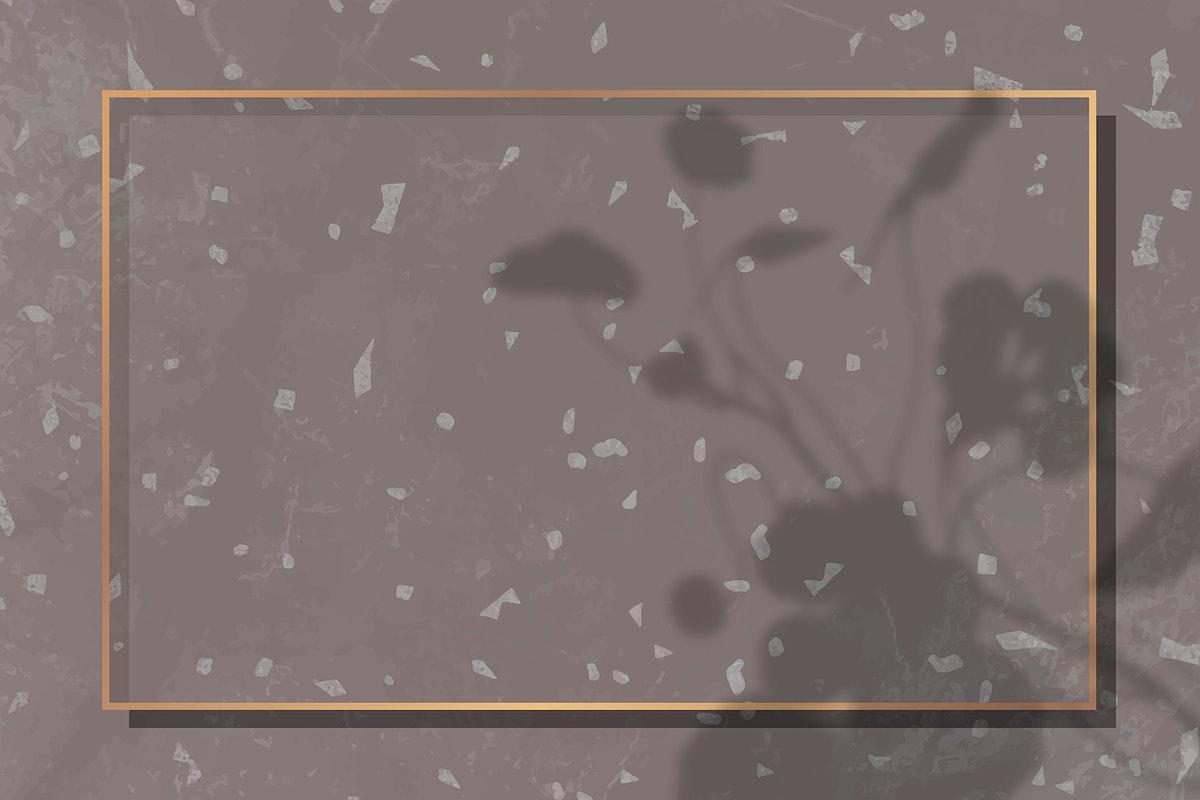 Rectangle gold frame on leaf shadowed brown background vector