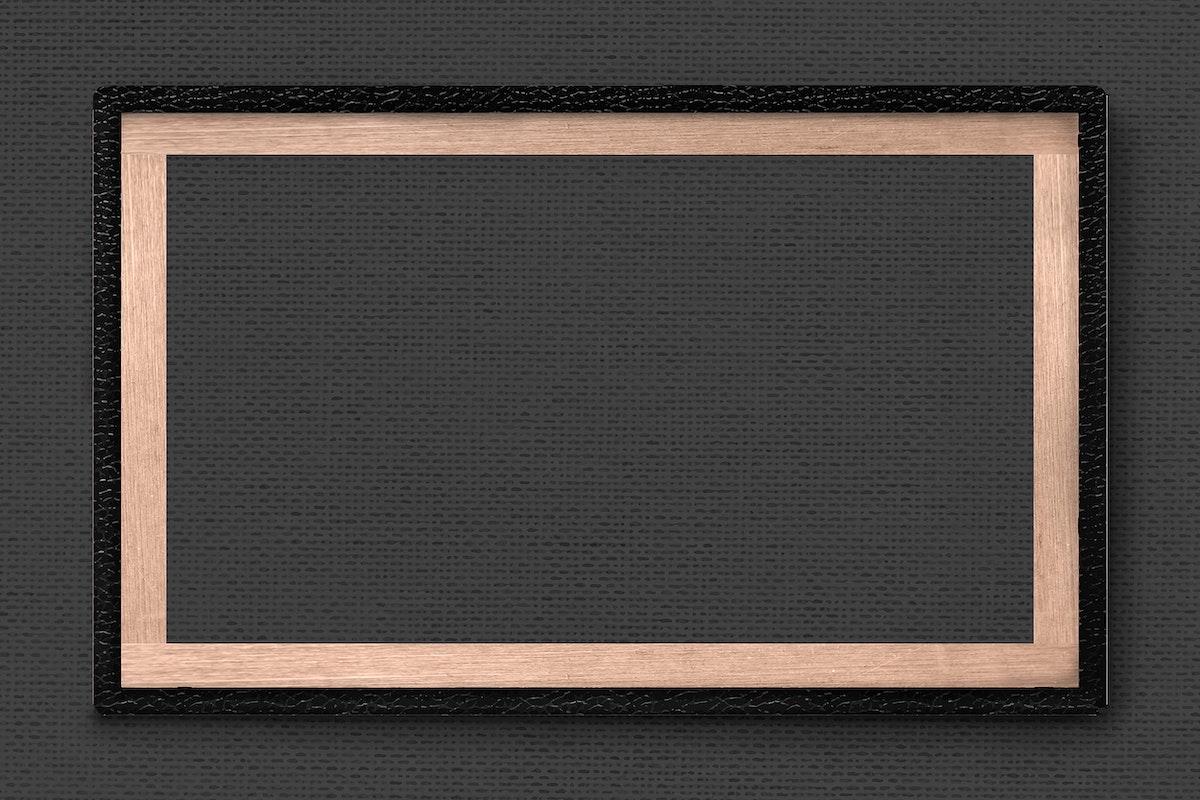 Black leather frame on dark background vector