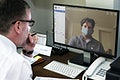 Colleagues having a video conference on a laptop mockup during the coronavirus pandemic